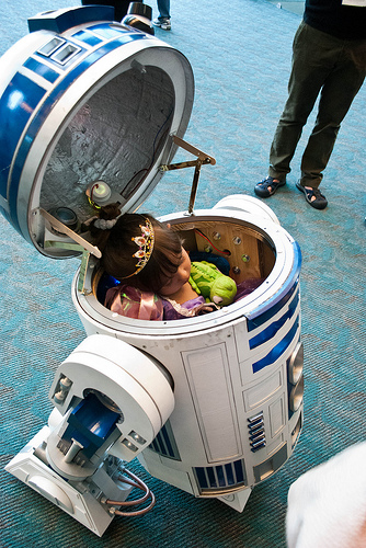Princess sleeping inside an R2-D2