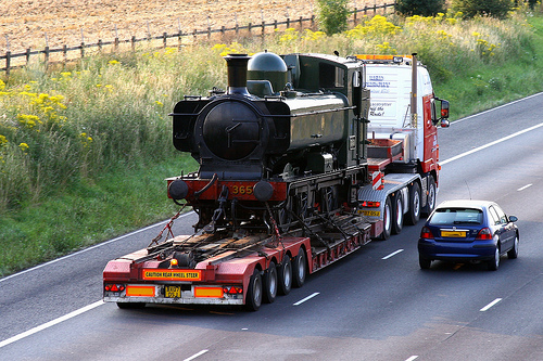 Train on the back of a semi-truck